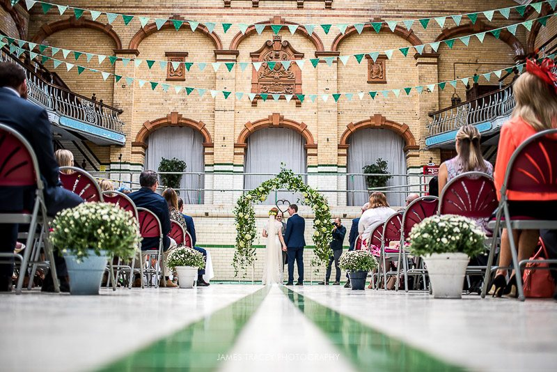 Wedding ceremony being held in a swimming pool