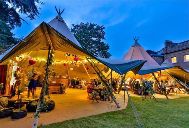 Beautiful wedding reception being held in a tipi.