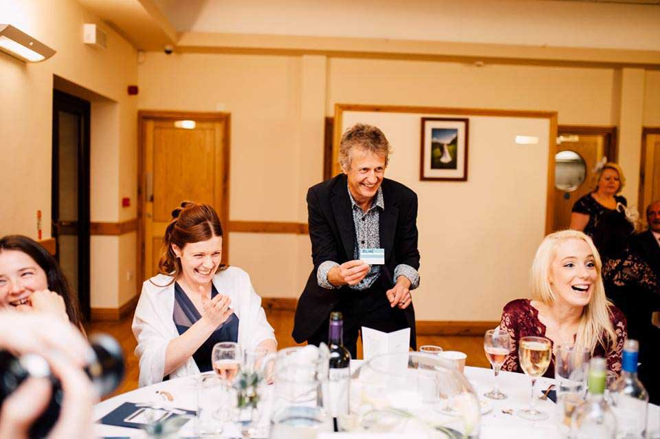 Luke performing magic at a wedding near Bridgend