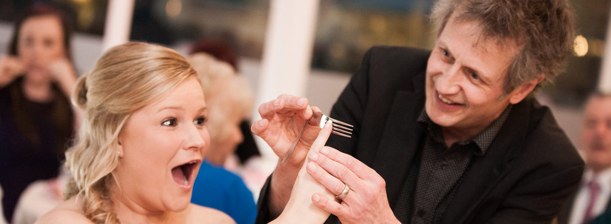 Bending a fork at a table