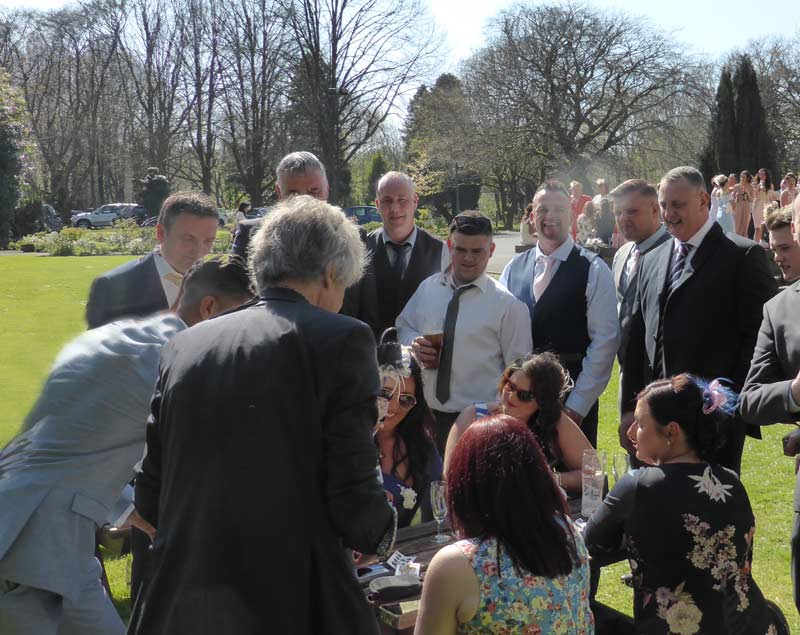 Clydach magician performing for wedding guests in the hotel grounds