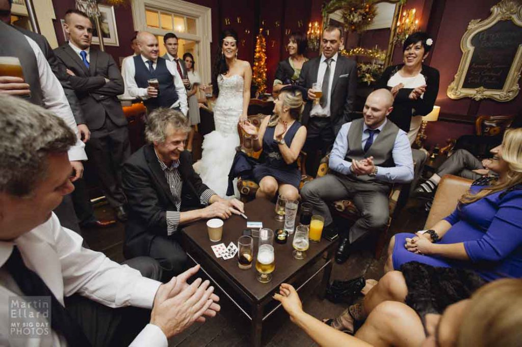 Magician performing magic for guests at a wedding in Brecon